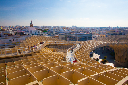 Seville, Spain - November 19,2016: Metropol Parasol is the modern architecture on Plaza de la Encarnacion.It was designed by the German architect Jurgen Mayer-Hermann.