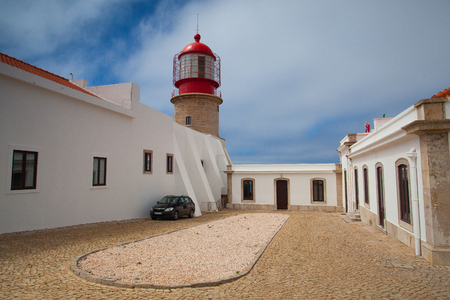 Sintra, Portugal, July  5, 2014: Lighthouse of Cabo de Sao Vicente, Sagres,Algarve,Portugal.  Cabo da Roca lighthouse was the first purpose built light house in Portugal and was completed in 1772 but its present form originates from 1842.