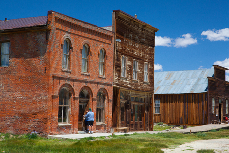 Bodie, CA, USA - July 15, 2011: Old buildings in Bodie, an original ghost town from the late 1800s. Bodie is a ghost town in the Bodie Hills east of the Sierra Nevada mountain range in Mono County, California