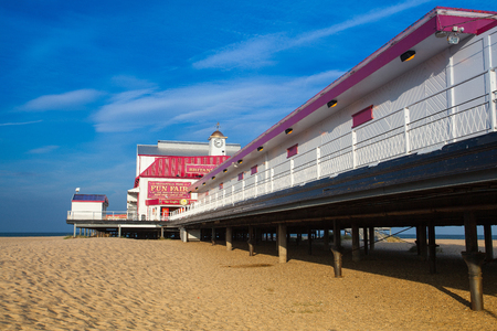 Great Yarmouth, Great Britain - July 8,2010: Famous Britannia pier in in Great Yarmouth. The pier was first proposed in 1856 and work began in 1857. The Pier still provides popular live theatre shows and boasts a range of food outlets, bars...