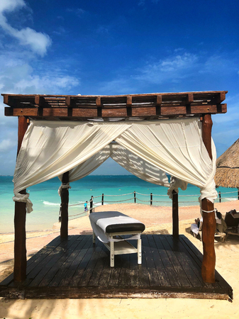 On a beach in Cancun.Cancun, a Mexican city on the Yucatan Peninsula bordering the Caribbean Sea, is known for its beaches, numerous resorts and nightlife. Stock Photo