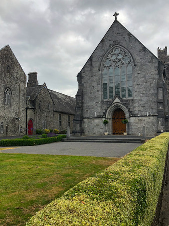 Holy Trinity Abbey Church is now the Roman Catholic parish church in the centre of the picturesque nineteenth-century estate village of Adare.