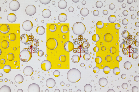 Flags  of Vatican City behind a glass covered with raindrops. 3D illustration Stock Photo