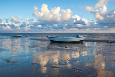 Fishing boats on the empty beach, Hjerting, Jutland, Denmark. Hjerting is a district of Esbjerg in southwest Jutland, Denmark