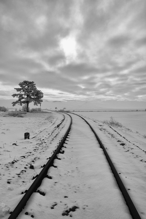 Single railway track in winter landscape. Central Bohemian Uplands, Czech Republic
