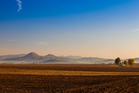 Autumn landscape with agricultural land, recently plowed and prepared for the crop.Central Bohemian Upland, Czech Republic. Panorama picture.