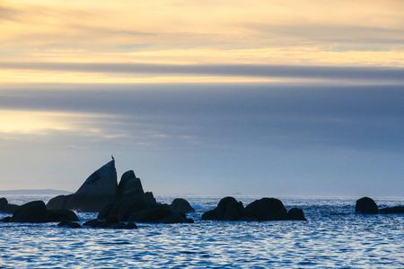 Sunset on Con Negro beach, de Pontevedra, Galicia, Spain. Coastal rocks on Con Negro beach.