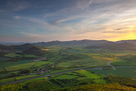 View from Lovos Hill. Sunset  in Central Bohemian Highlands, Czech Republic. Central Bohemian Uplands  is a mountain range located in northern Bohemia. The range is about 80 km long.