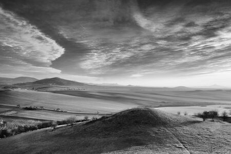 Sunrise in Central Bohemian Highlands, Czech Republic. Central Bohemian Uplands  is a mountain range located in northern Bohemia. The range is about 80 km long. Black and White Photography. Фото со стока