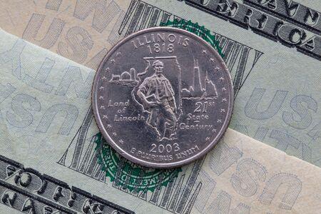 A quarter of Illinois on US dollar bills. Symmetric composition of US dollar bills and a quarter of Illinois .