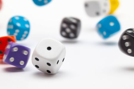 White dice on the white table. Playing dice at white wooden background. Playing a game with dice. Risk concept. Standard-Bild