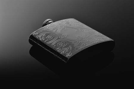 Stainless hip flask on the black glass table. Flask for alcohol. Lifestyle and travel.
