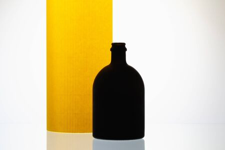 Luxury Black Glass of Rum on the yellow  background Reklamní fotografie