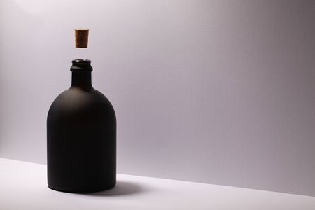 Luxury Black Glass of Rum on the white background