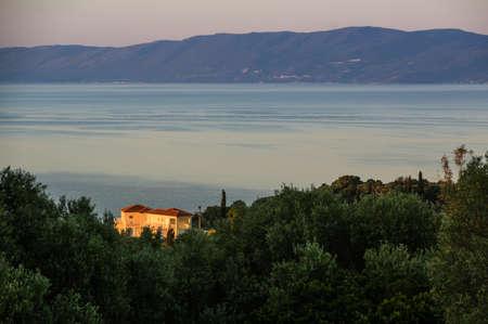 holiday villa: Kefalonian holiday villa lit by the sunrise. Stock Photo