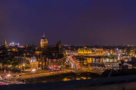 benelux: Amsterdam skyline at night with the fun fair visible in Dam Square.