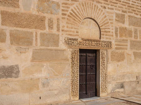 sightseers: A carved wooden door in the Tower of the Great Mosque in Kairouan.
