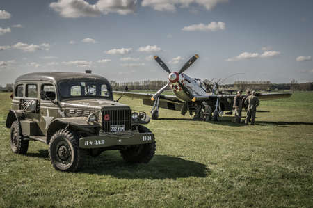 reenacting: HARDWICK AIRFIELD NORFOLK UK  APRIL 18  The airfield hosts a unique photographic event with restored military aircraft and volunteers reenacting scenes from WW2. 18 April 2015 in Norfolk.