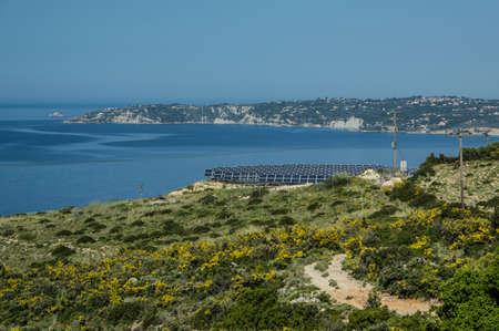 solar farm: Solar farm on the island of Kefalonia with the sea in the background.