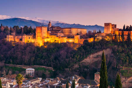 Alhambra Granada and Sierra Nevada Mountains in Andalusia, Spain around Sunset