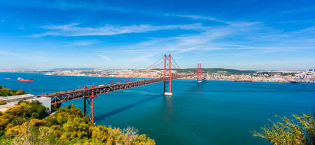 Panoramic view on the April 25th Bridge crossing the Tagus river in Lisbon, capital of Portugal