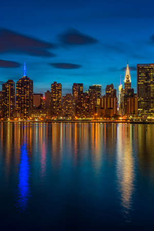 Midtown Manhattan NYC at nightfall, captured from Long Island City across the East River