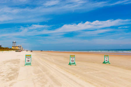 Traffic lanes on Beach or Daytona Beach, Florida, USA. The city is historically known for its beach where the hard-packed sand allows motorized vehicles to drive on the beach, in restricted areas.