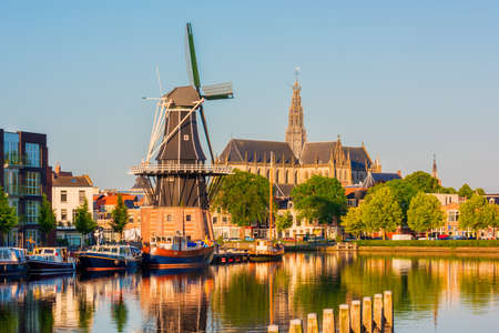 "Skyline of Haarlem, North Holland, Netherlands, with Windmill ""De Adriaan"" from 1779 and 13th Century Saint Bavo Church. The Spaarne river flows through Haarlem."