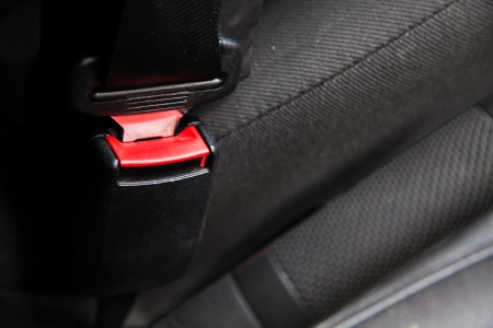 Red seat belt in car photo