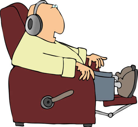 recliner: Man listening to headphones while sitting in a recliner Stock Photo