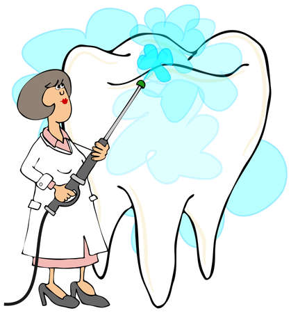 hygienist: Female dentist cleaning a tooth Stock Photo