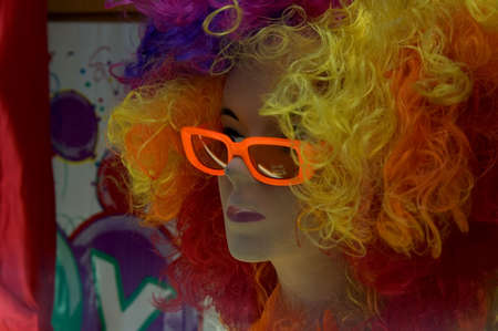 mimetism: mannequin with colored hair and sunglass Stock Photo