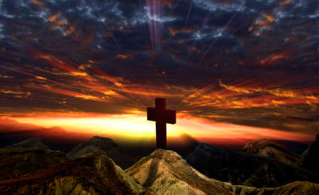 Crucifix , sunset and mountain