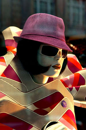 woman with a hat, sunglass and a reto style photo