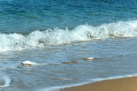 transparence: detail of waves arriving on a beach Stock Photo