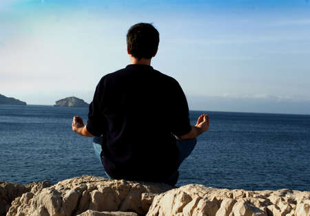 mens meditation in front of the sea