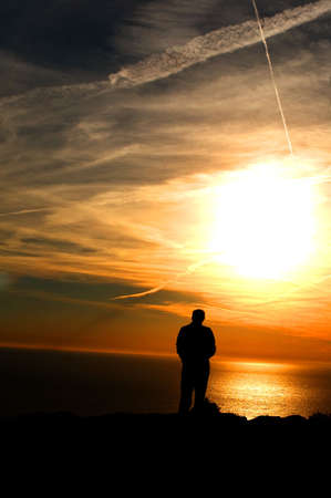 seasides: Small humain silhouette face to the immensity : pryer and meditation