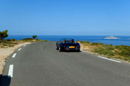 luxury car and road with view on the sea photo
