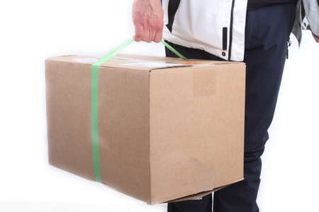 courier: courier with parcel shipment in hand Stock Photo