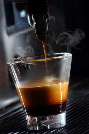 expressed: espresso machine making coffee at bar Stock Photo