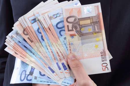 Homme d'affaires avec de l'argent euro Banque d'images - 53374279