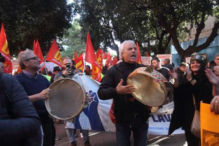 Taranto, Italy - November 29, 2019: Ex Ilva, the USB general strike with protesters and slogans in the city