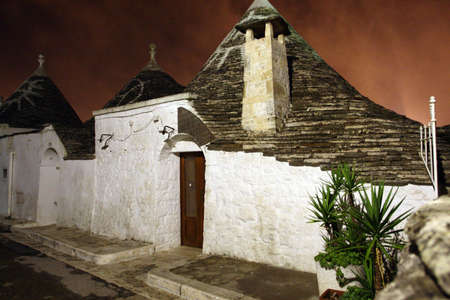 Alberobello, Italy - October 6, 2010: the characteristic houses called trulli