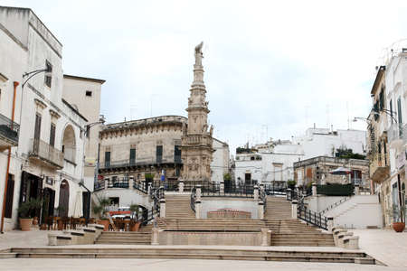 Ostuni, Italy - October 6, 2010: View of the square with the Column of Sant'Oronzo
