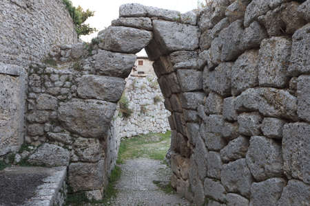 Arpino, Italy - September 16, 2020: The round arch at the entrance to the ancient city on the acropolis of Arpino