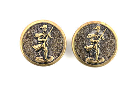 commemorative:  A close view of two commemorative buttons.