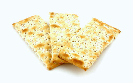 browned: Three nicely browned wheat crackers on white background.