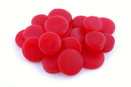 satisfying: Nice view of red candies on a white background. Stock Photo