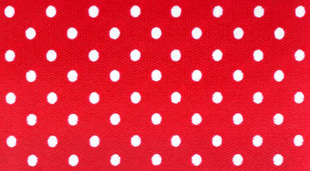 Bright colorful trimming, white polka dots on red background. photo