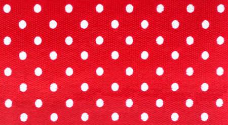 red polka dots: El recorte de colores brillantes, lunares blancos sobre fondo rojo.